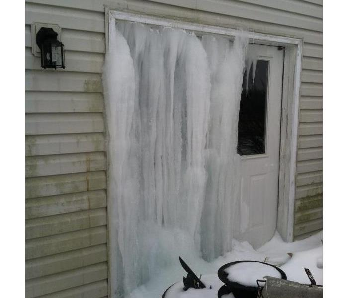 Water frozen on house